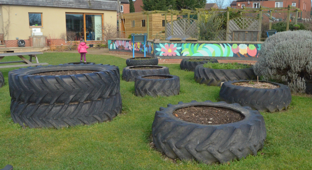How does your community garden grow growing family - Garden ideas using tyres ...