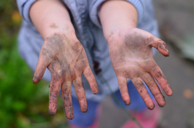 children gardening mucky hands