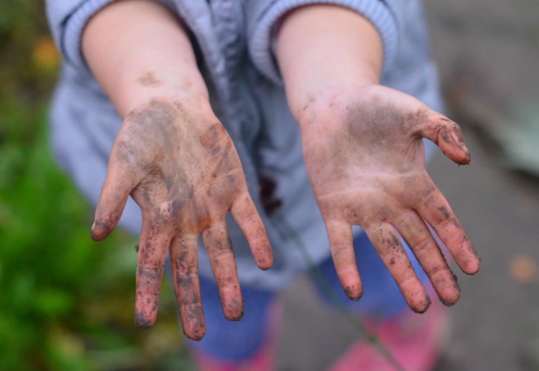 kids gardening mucky hands