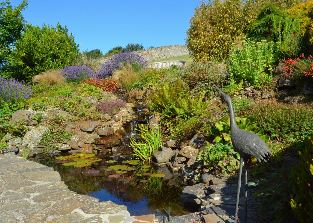 english coastal country garden pond