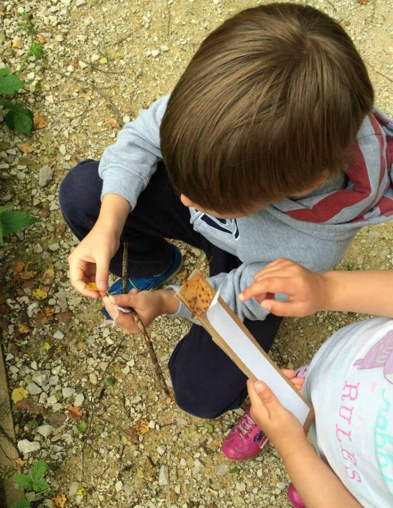 children collecting natural materials