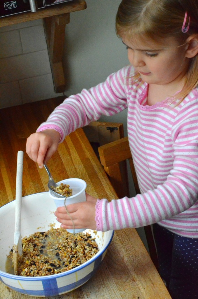 winter nature craft making homemade bird feeders