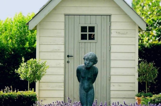 choosing the right shed for your garden - shed with statue