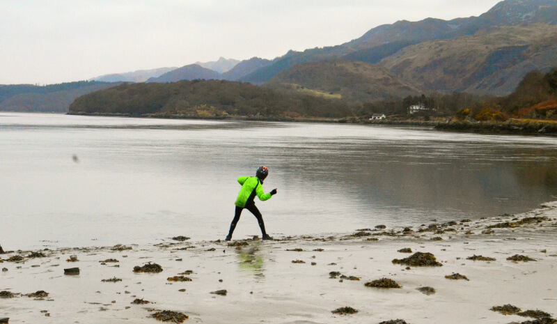 a family adventure in wales skimming stones on the mawddach estuary trail