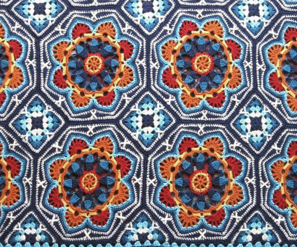 accessorise a summer garden party with a colourful persian tile design blanket