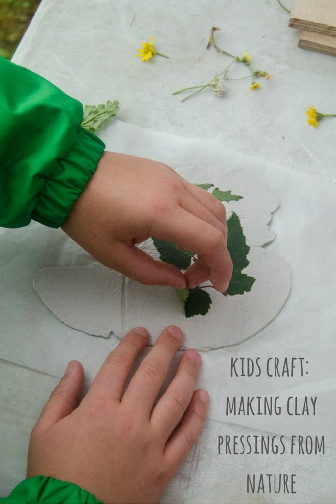 clay craft with natural materials - adding leaves to clay
