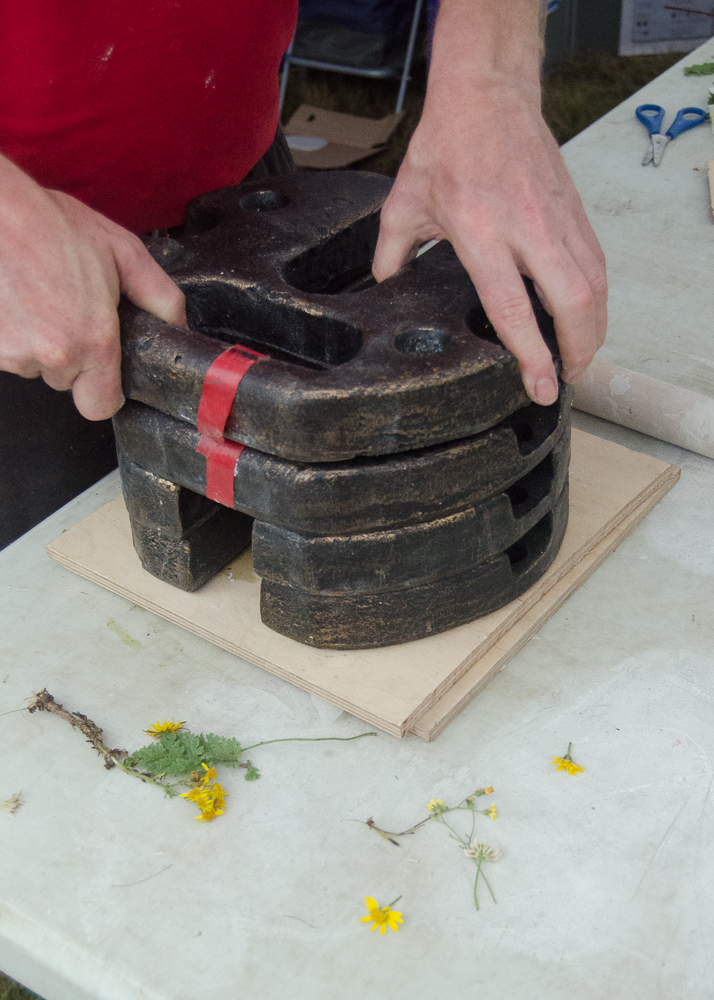 clay craft with natural materials - pressing the clay