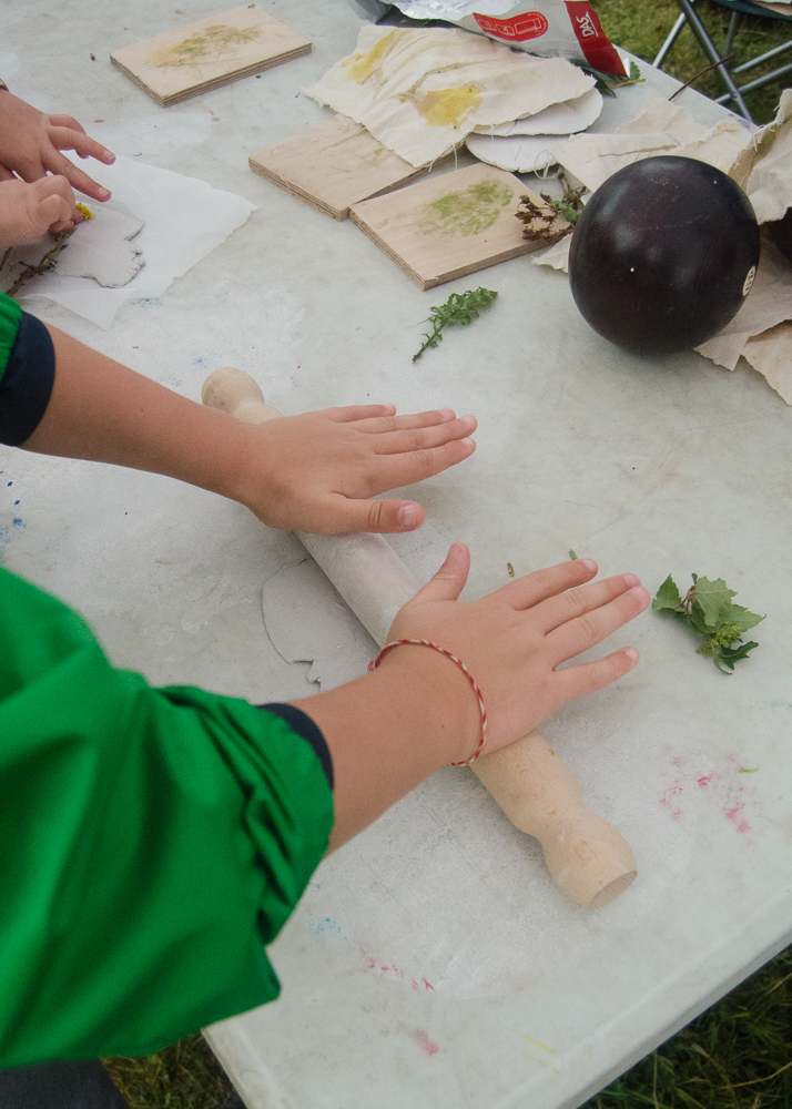 clay craft with natural materials - rolling out clay