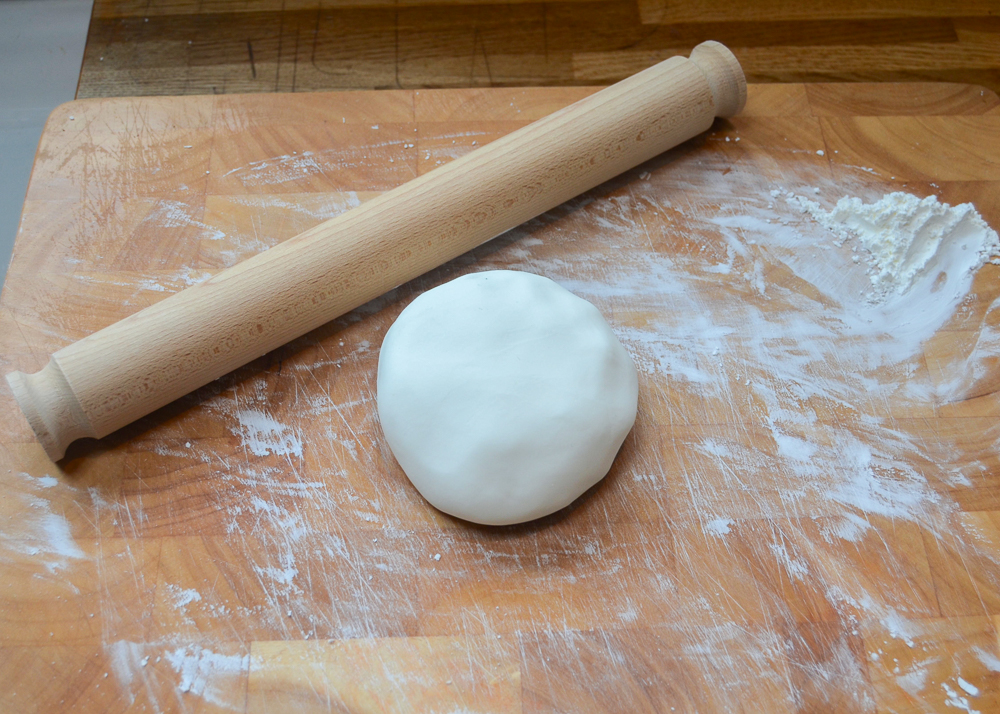 rolling out baking soda dough