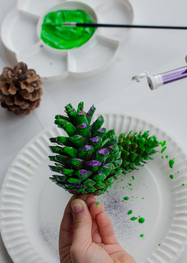 Adding glitter to painted pine cones