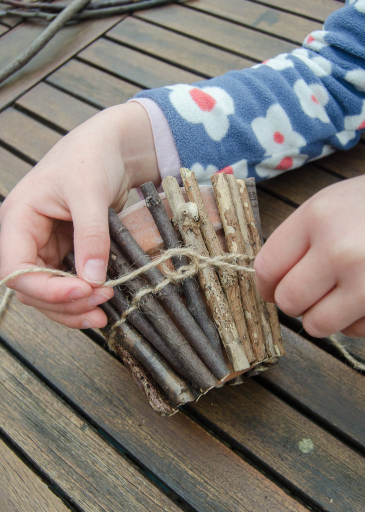 How to make your own twig wrapped flower pots - a simple and fun nature activity for children, great for a homemade mother's day gift!