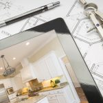 Computer Tablet Showing Finished Kitchen Sitting On House Plans With Pencil