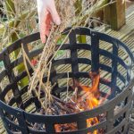 Aragon Cast Iron Fire Basket adding sticks