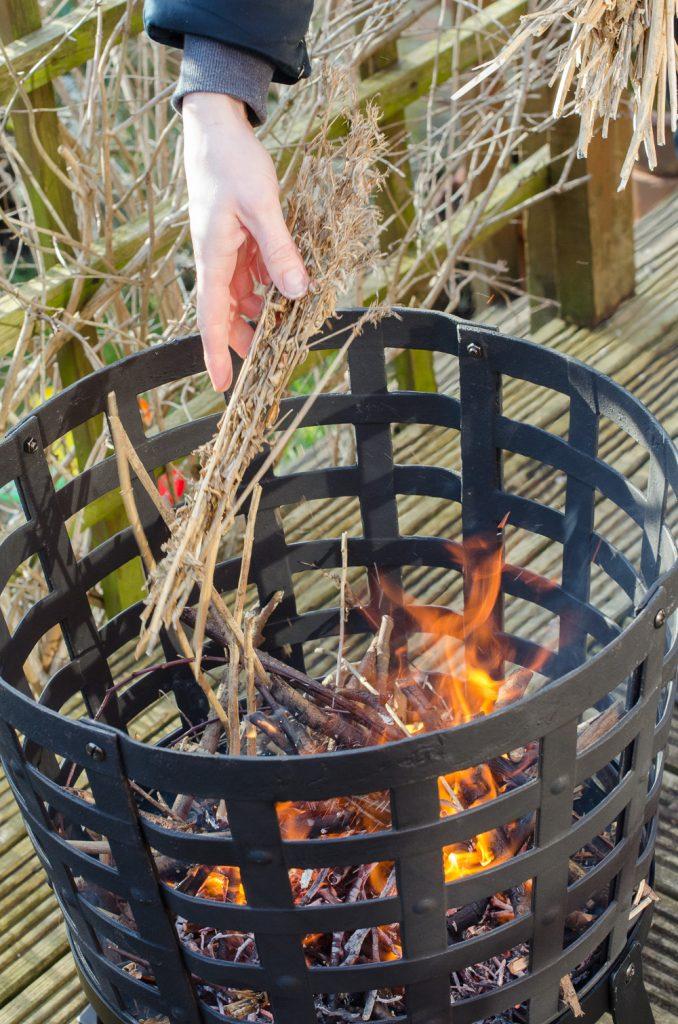 Aragon Cast Iron Fire Basket adding sticks