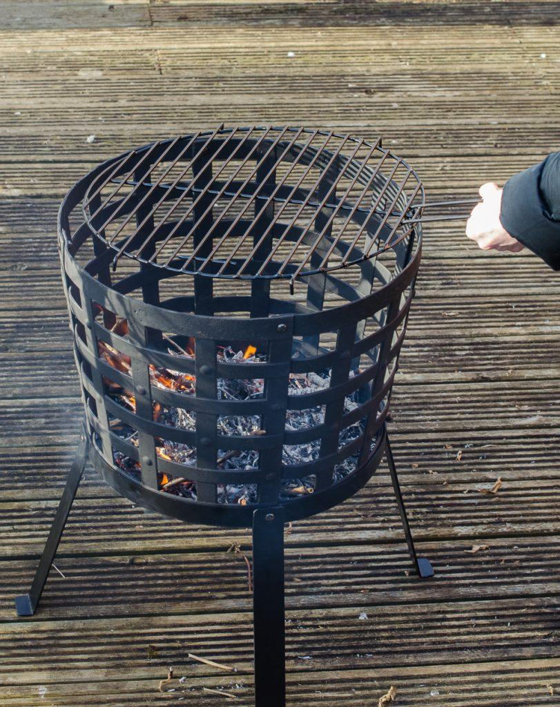 Aragon Cast Iron Fire Basket placing grill