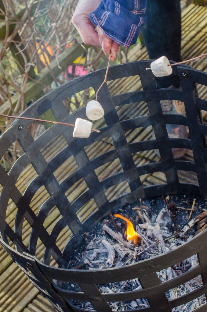 Aragon Cast Iron Fire Basket toasting marshmallows