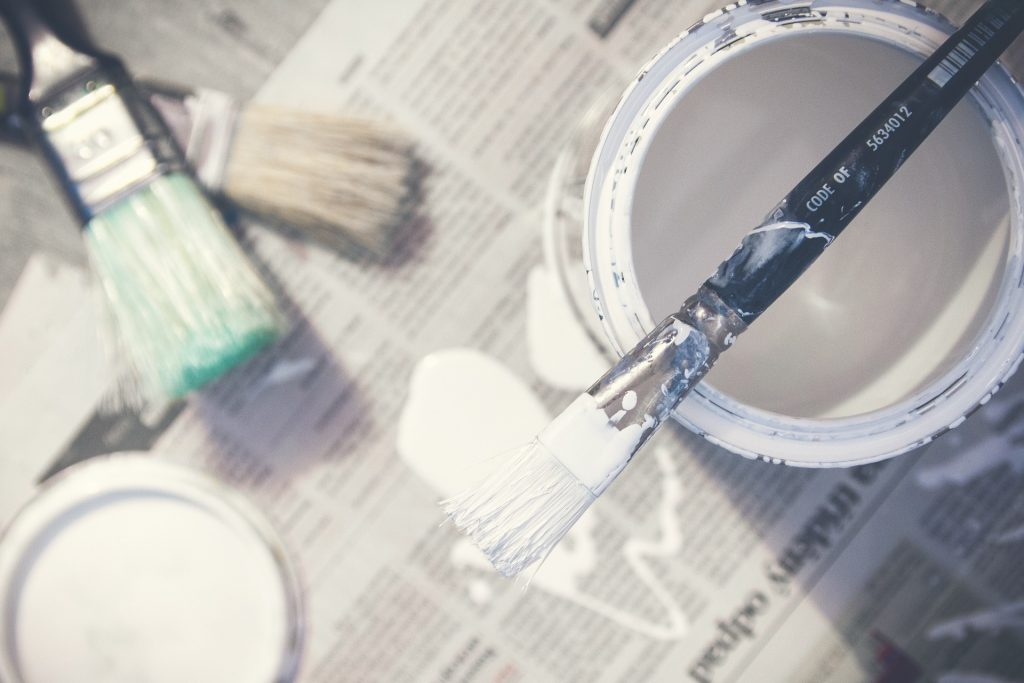 paint tin and paintbrush