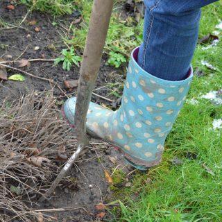 digging the garden in wellies
