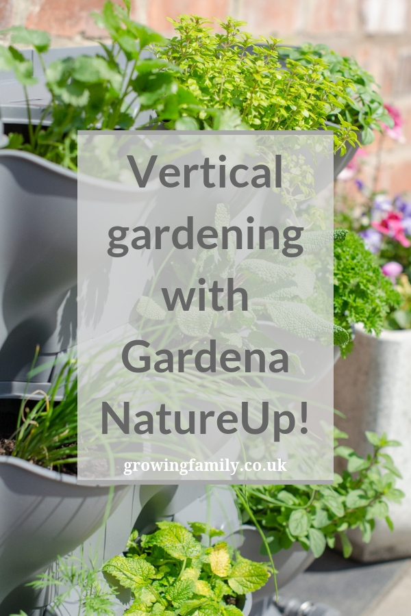 Creating a vertical herb garden using the Gardena NatureUp! vertical gardening system, which is ideal for small outdoor spaces and container gardening.