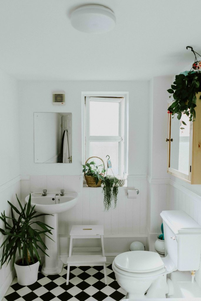 white bathroom with checked floor tiles