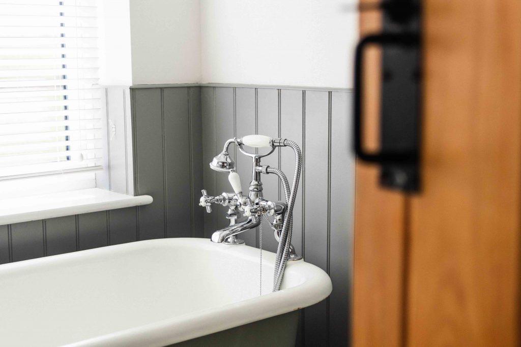 traditional bathroom with freestanding bath