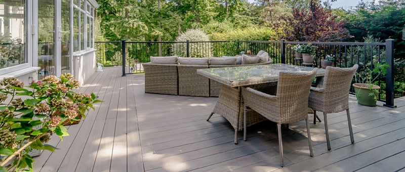 decking trends 2020 composite decking area with railing and dining set