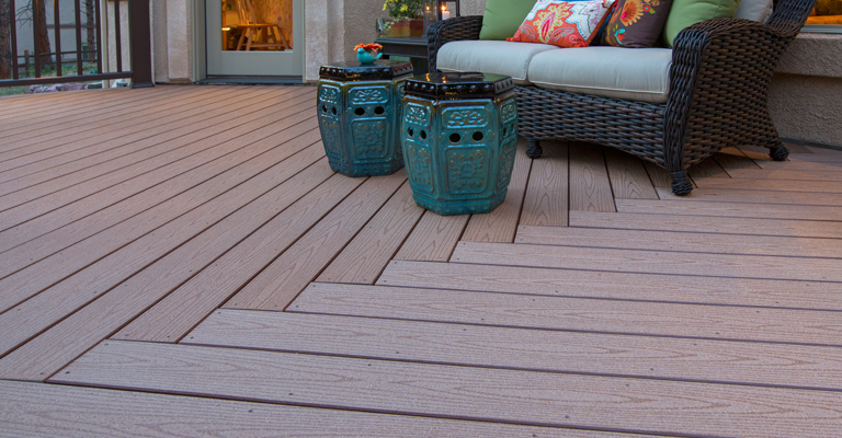 decking trends 2020: composite decking in cedar finish arranged in a chevron pattern