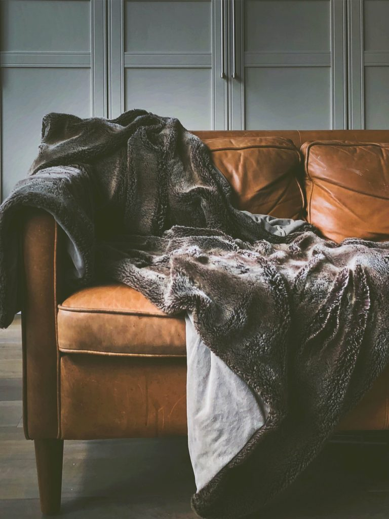 Cost-effective ways to keep your family warm - add throws to sofas