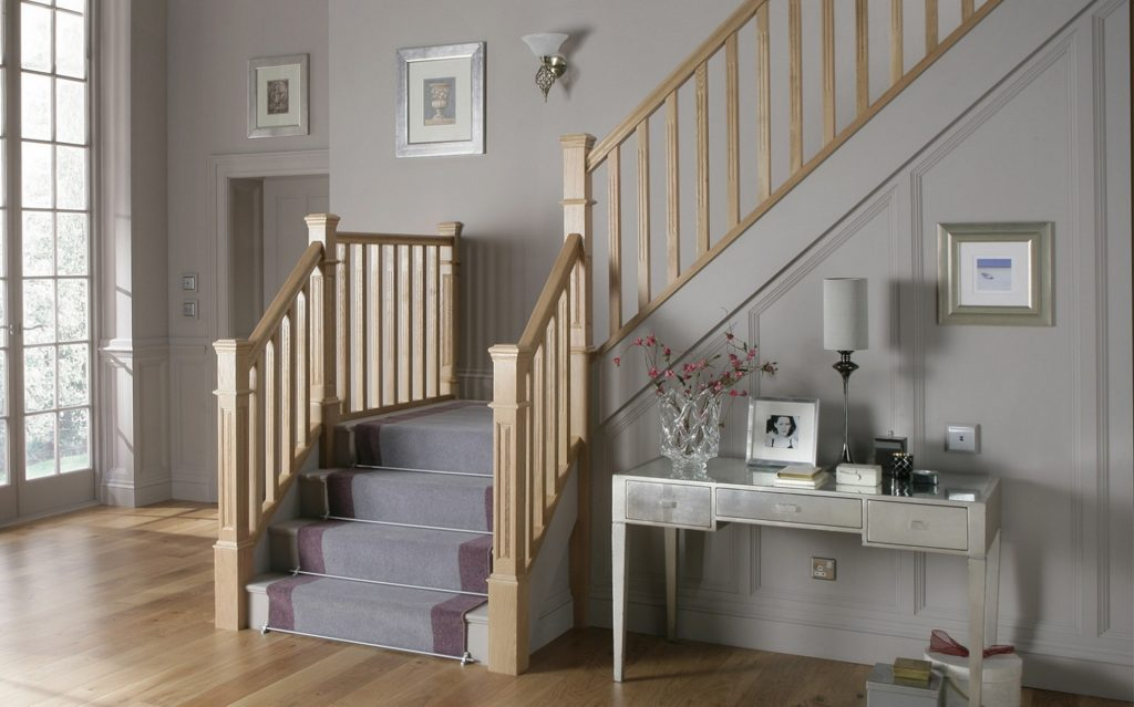wooden staircase with carpet runner