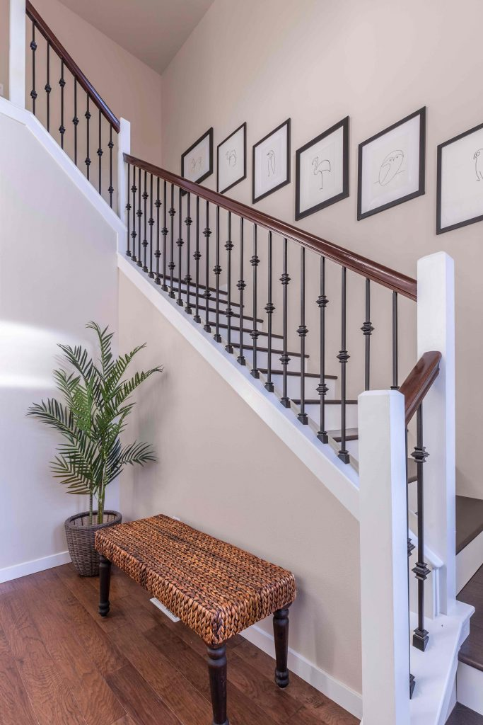 staircase with wooden banister and metal spindles