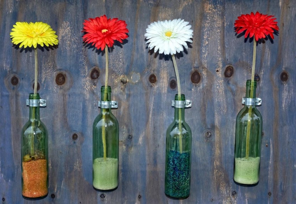flowers in bottle vases