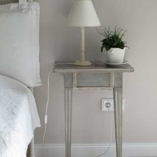 bedside table and bed