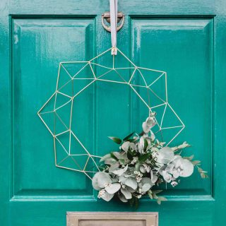 front door with modern wreath