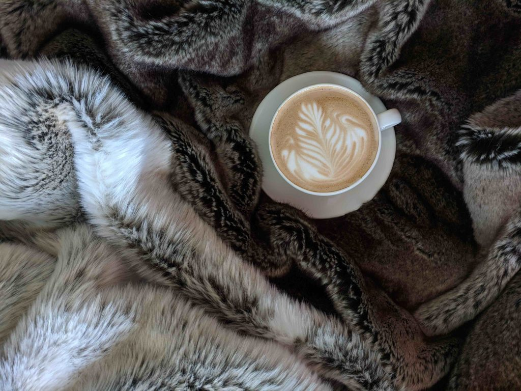 cost-effective ways to keep your family warm - blanket and warm drinks
