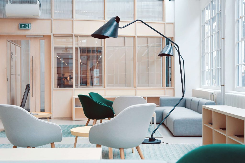 office space with casual chairs and floor lamps