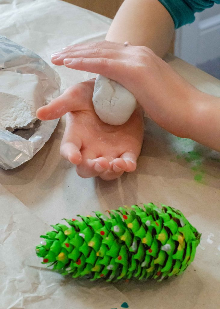 rolling air drying clay to make pine cone christmas trees