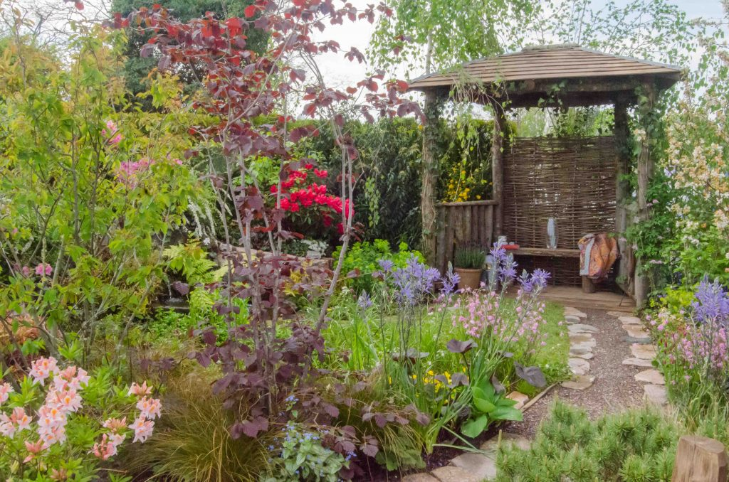 cottage garden with path and covered seat