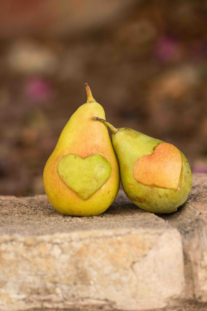 two pears with heart shapes