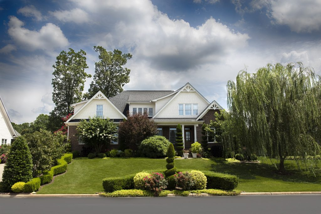 house with large front lawn