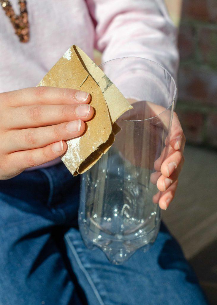 sanding a plastic bottle