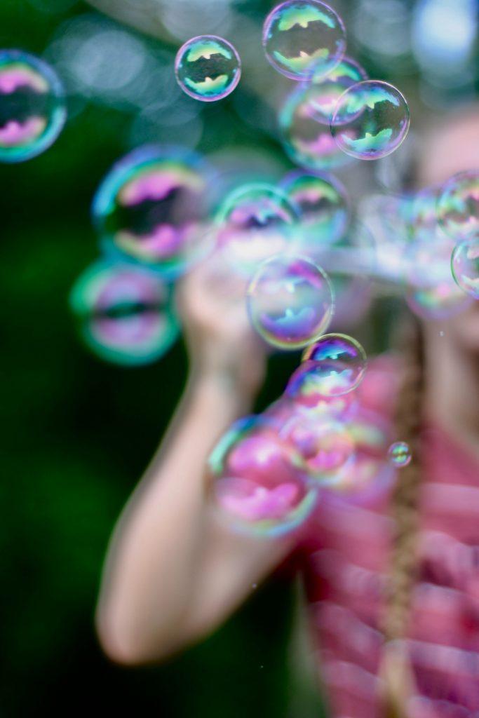 kids outdoor activities - blowing bubbles
