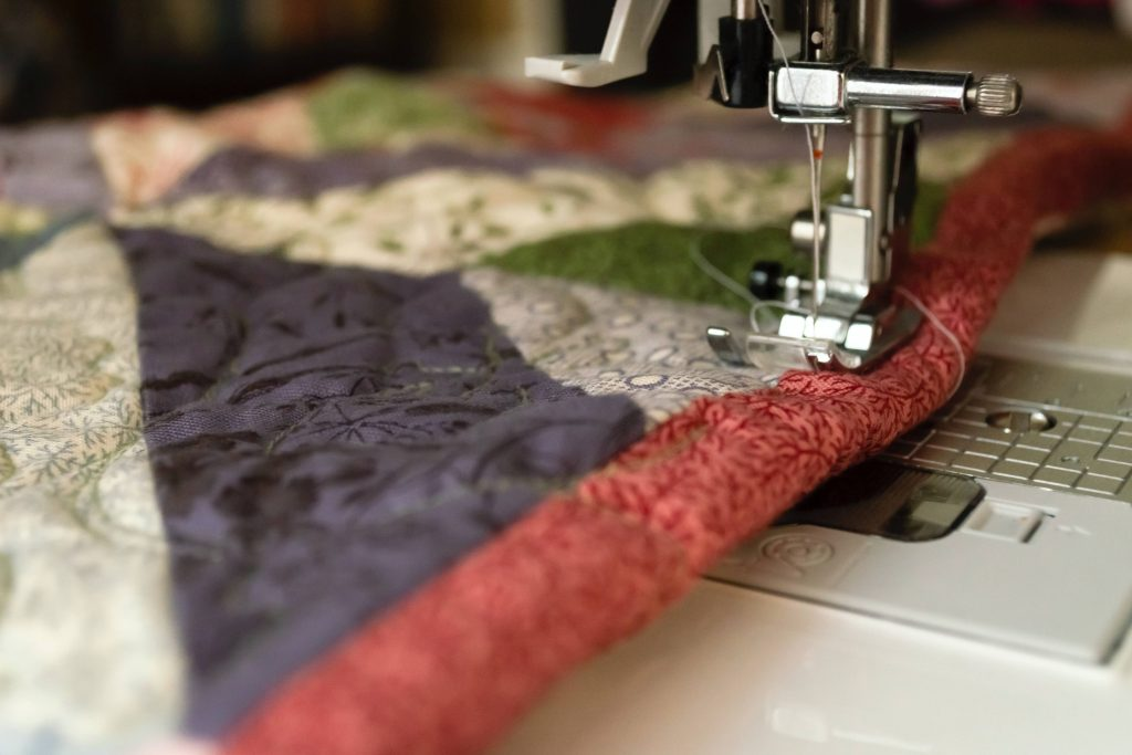 sewing machine foot stitching quilted fabric