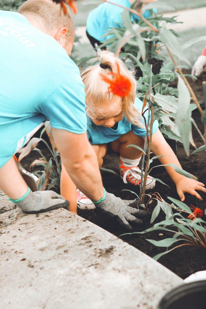 gardening for kids - child planting in a garden bed