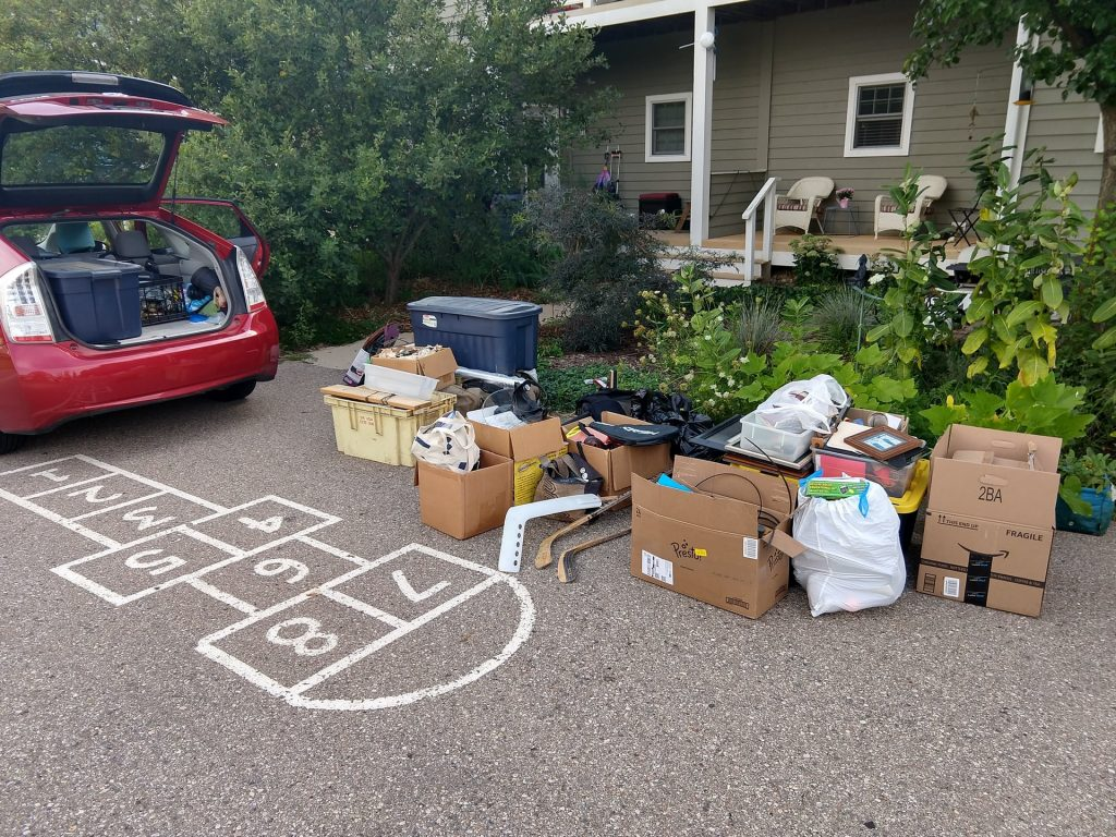 downsizing - packing boxes on drive outside house