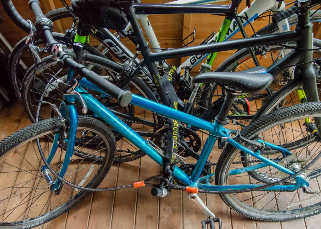 bikes secured with heavy duty chain and double loop cable
