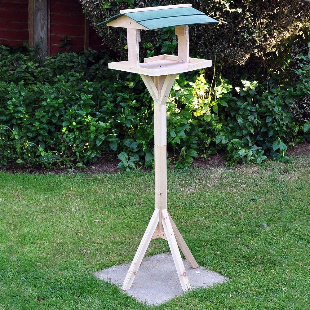 wooden bird table in garden